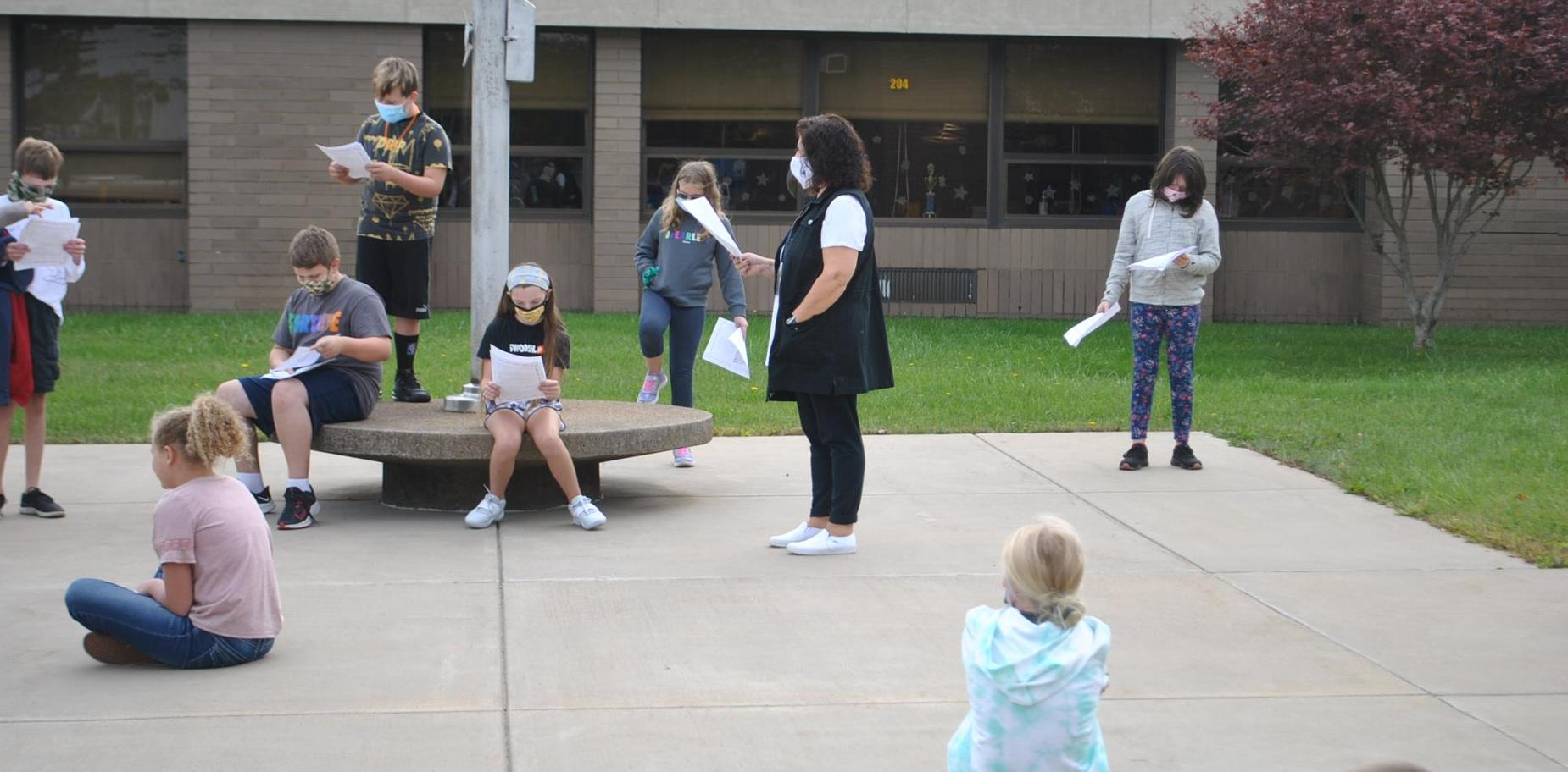 Students doing an outdoor play