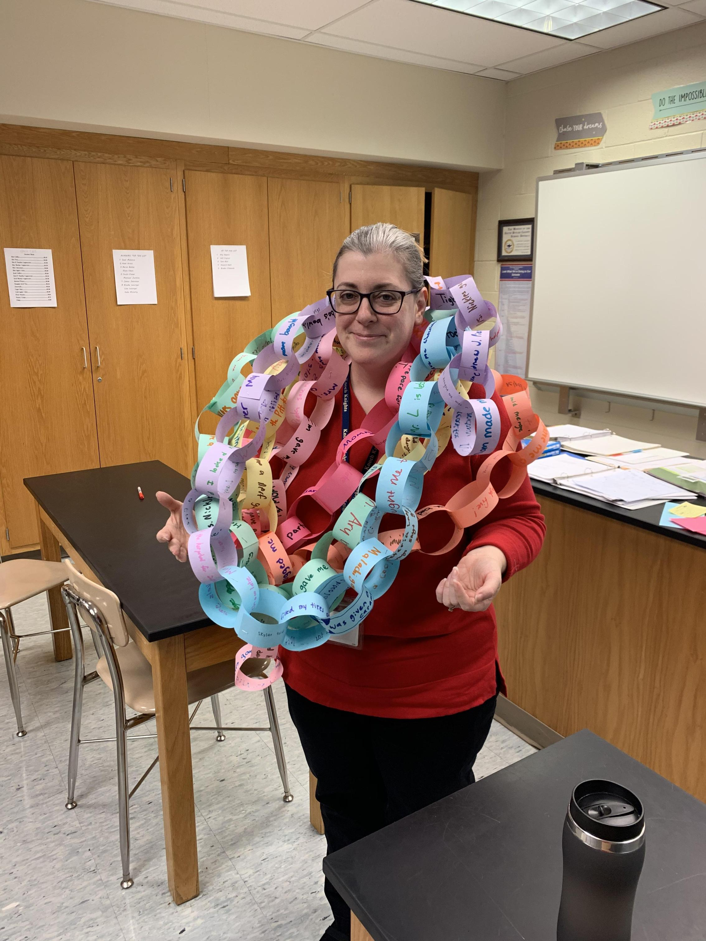 teacher wrapped in paper chain