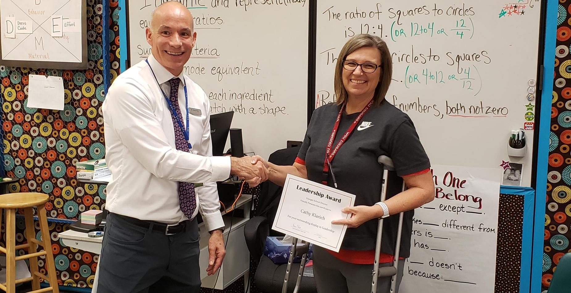 Mrs. Klarich receiving Leadership recognition from Supt. Dr. Brian Hart