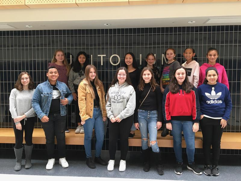 14 middle school students pose for a photo outside the auditorium, prior to performing in Bucks County Music Educators String Day.