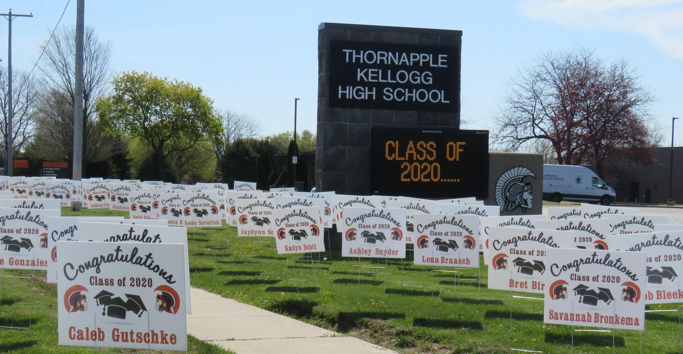 Signs fill the greenspace along the road supporting the Class of 2020.