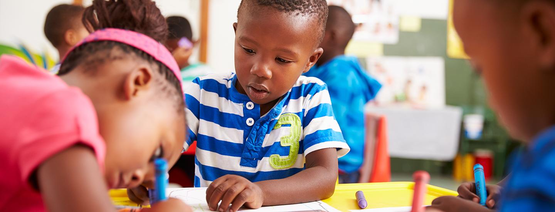 preschoolers drawing in classroom