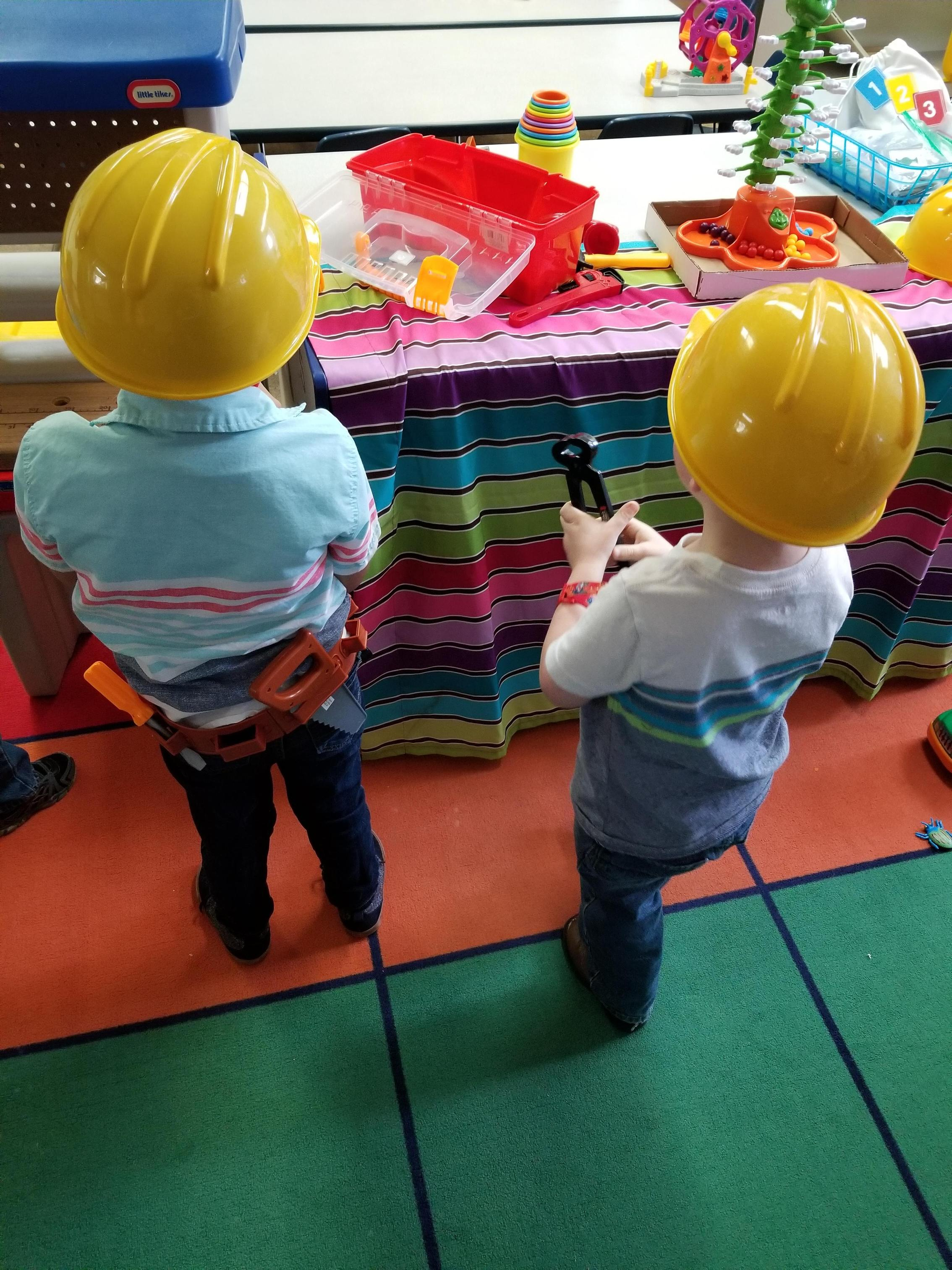 Boys working hard in Construction