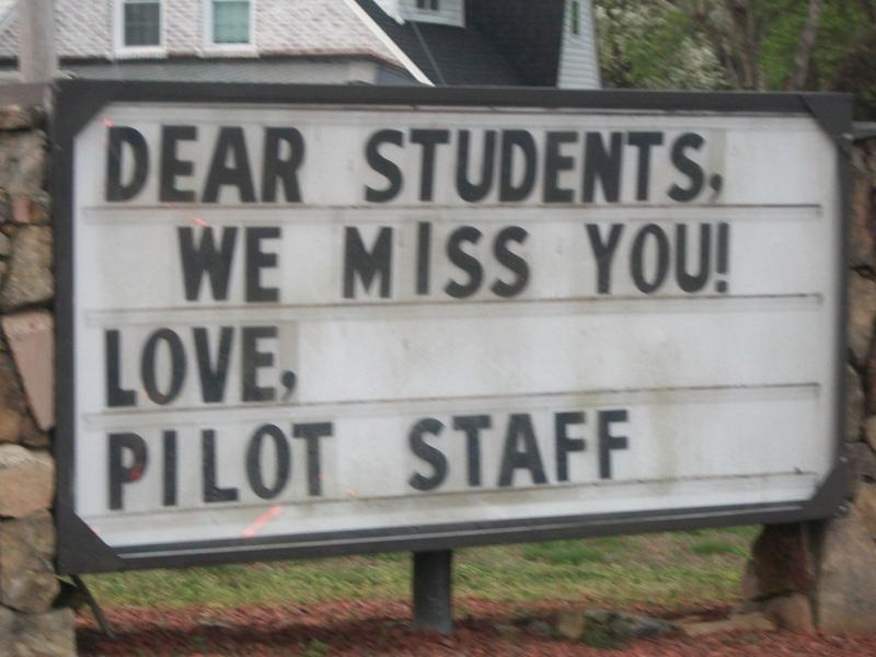 Pilot sign stating that students are missed by staff.