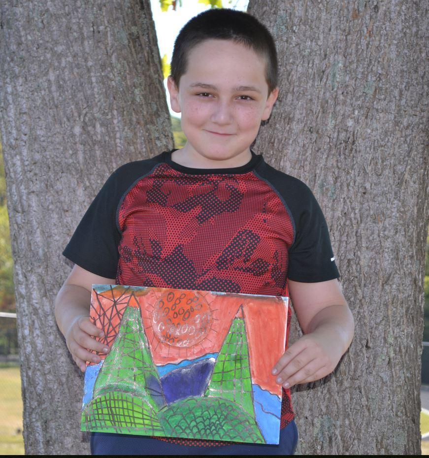 Boy holding his art work