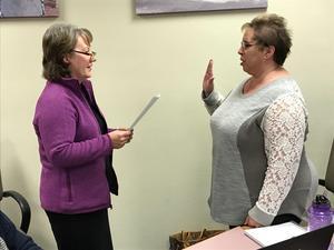 Sarah Divina being sworn in by Superintendent Imler