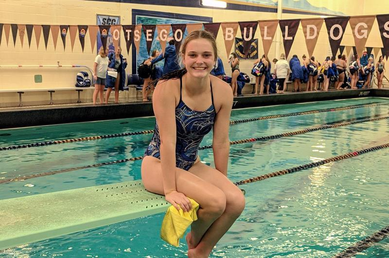 Abie Sullivan sitting on the edge of the diving board