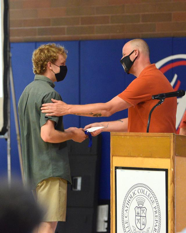 senior David Jensen accepts award from Mr. Paul Dreisbach