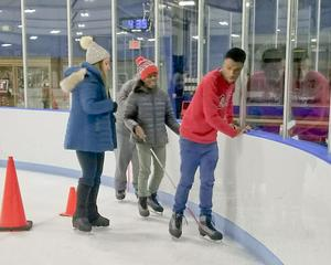 Two students learning to ice skate