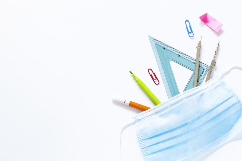 Mask with an assortment of school supplies