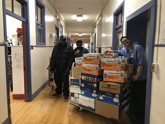School porters loading boxes of donations to the elevator