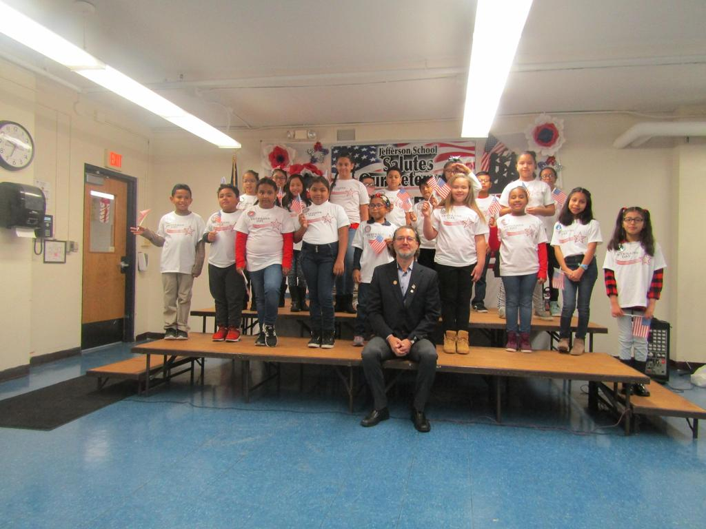 ms. logothetis 4th grade class signing with dr. williams