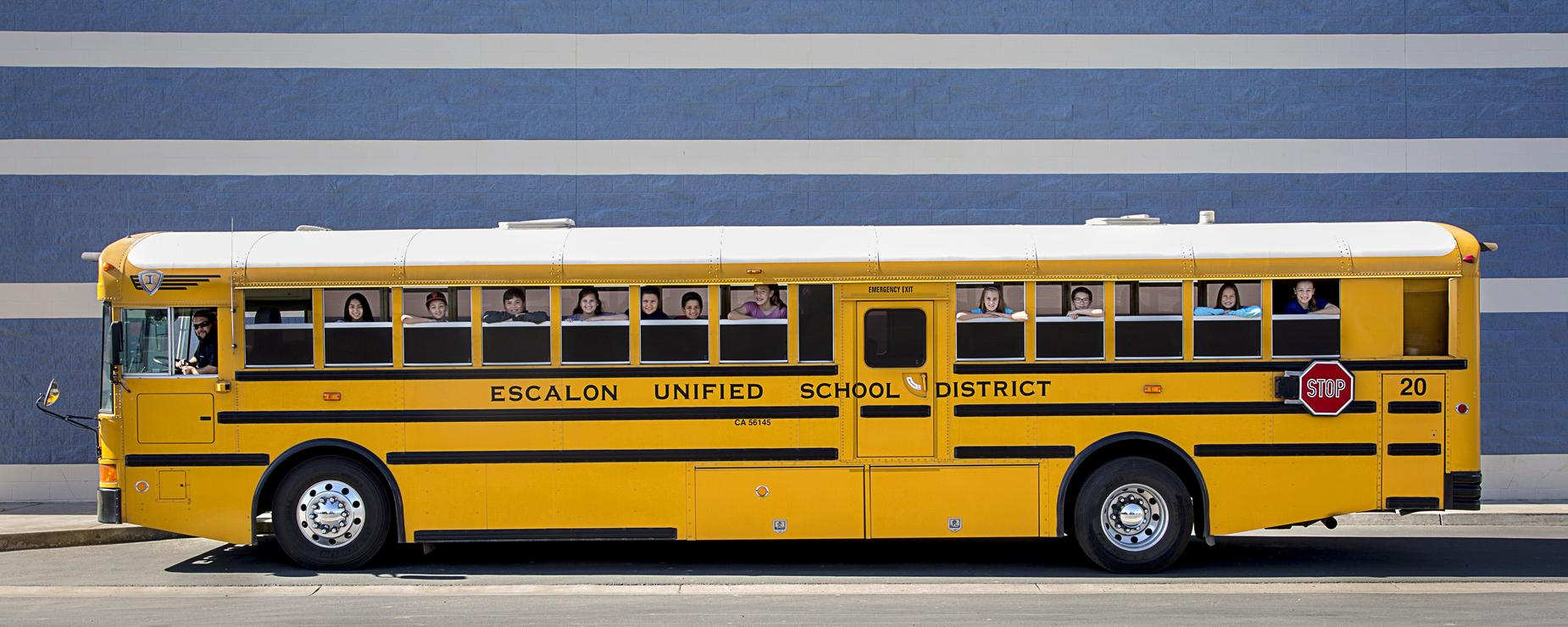 Escalon bus with driver and students looking out windows.