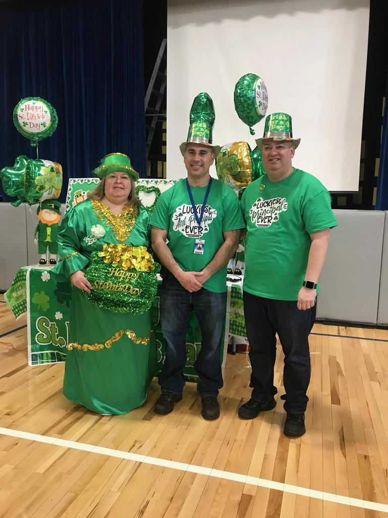 Mr.s Kanick, Mr. Ferrante, and Mr. Rivera all dressed in St. patty's green