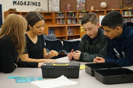 Students solve puzzles in group
