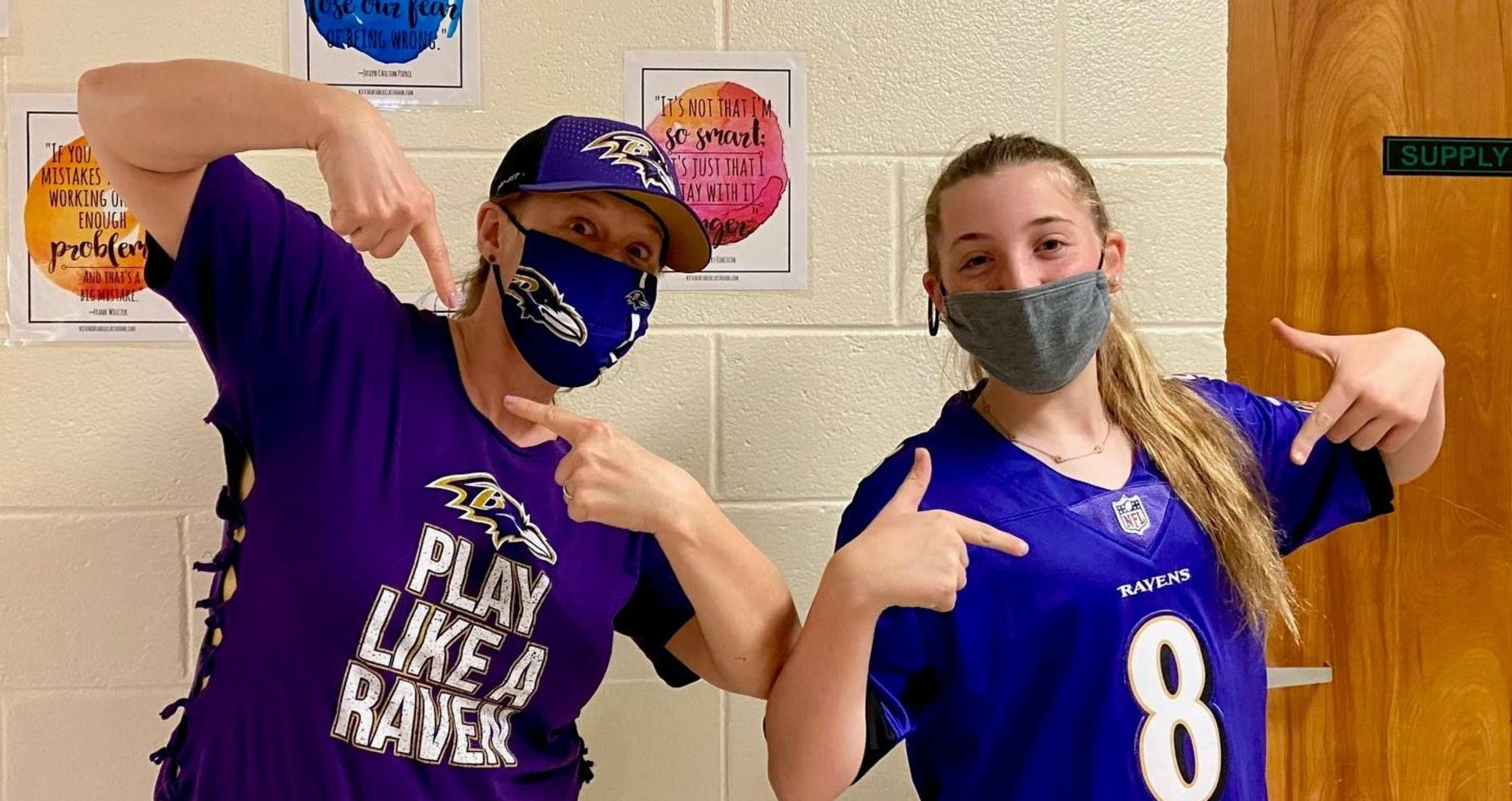 a picture of a student and teacher in Baltimore Ravens gear