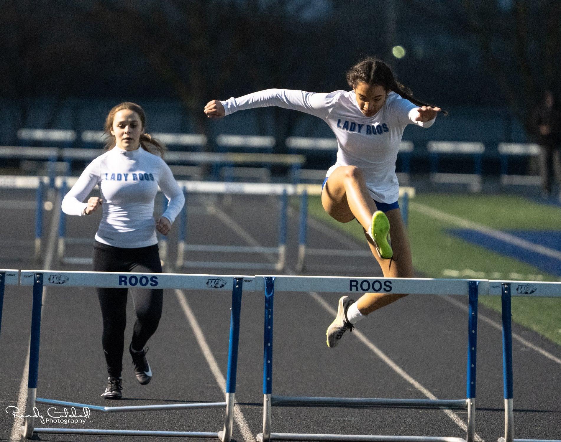 Roos Running Hurdles at a Track Meet