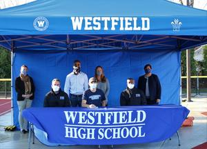 WHS senior Jack Kelesoglu will play soccer at Connecticut College next fall.   FR/LR:  Coach Eric Shaw, Jack Kelesoglu, Coach Demont Heard; BR/LR:  WHS Principal Mary Asfendis, Mr. and Mrs. Kelesoglu, Supervisor of Athletics Sandra Mamary
