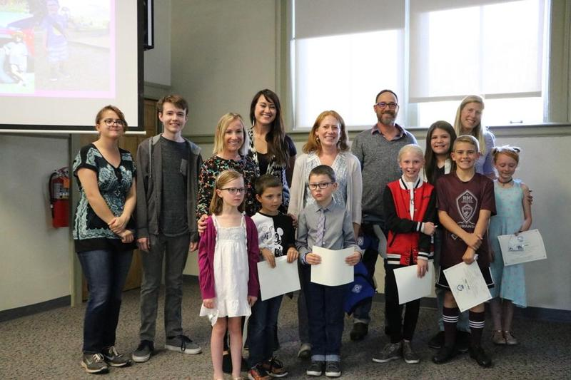 Picture of board members with students and staff who were recently recognized for achievements.