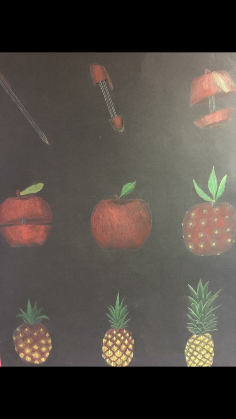 black paper, apple changing into a pineapple