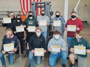 Students holding OSHA certificates