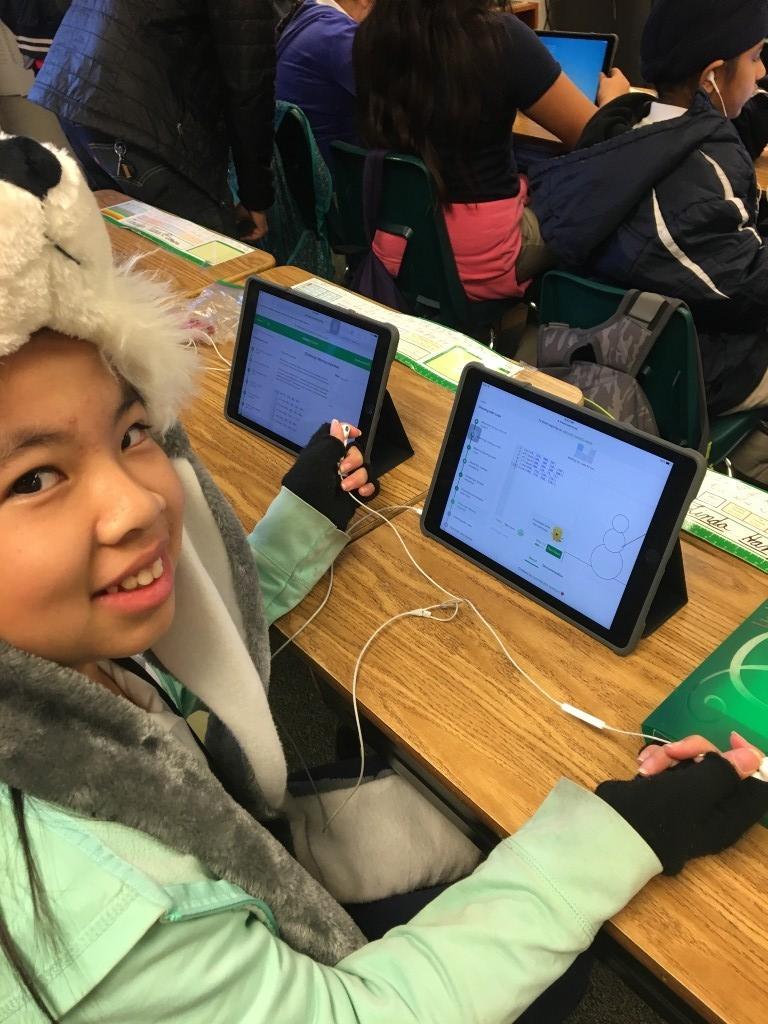 Smiling girl on iPad