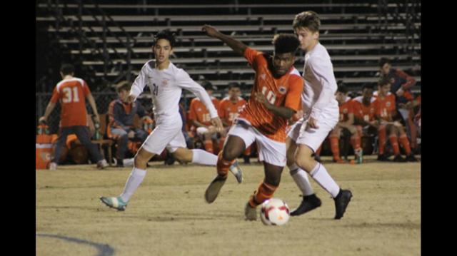 Adrian Eaglin kicking the soccer ball.