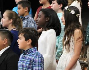 Photo of Tamaques Grade 5 chorus performing in winter concert.