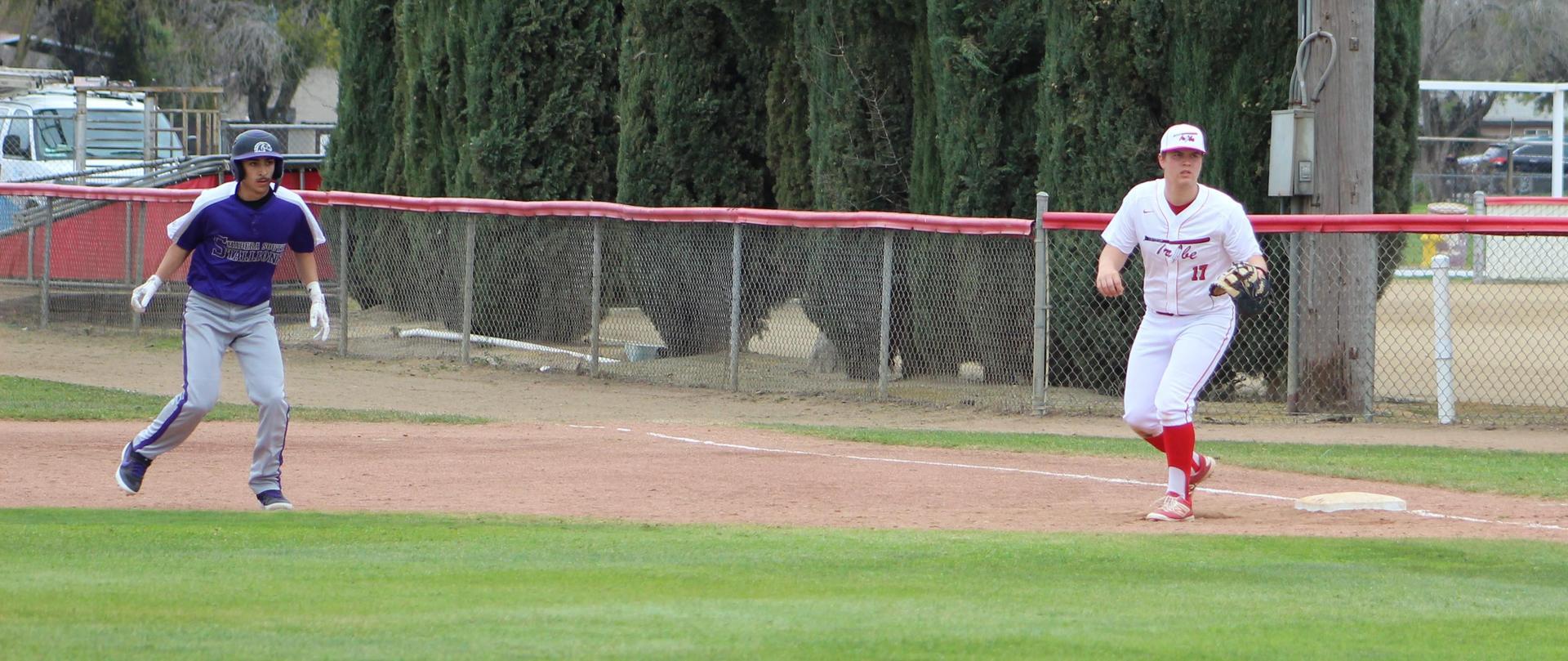 Varsity boys playing baseball against Madera South