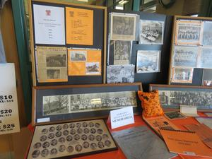 A large display of alumni memorabilia was displayed including yearbooks, photos and letterman jackets.