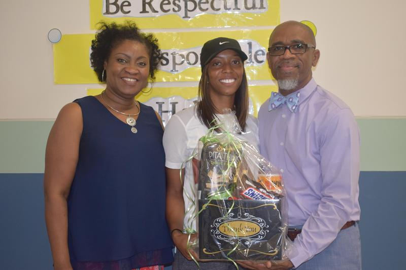 MHS Alumni, Alisha Rayborn, receive Acts of Kindness Baskets from Dr. Cederick Ellis at Otken Elementary School