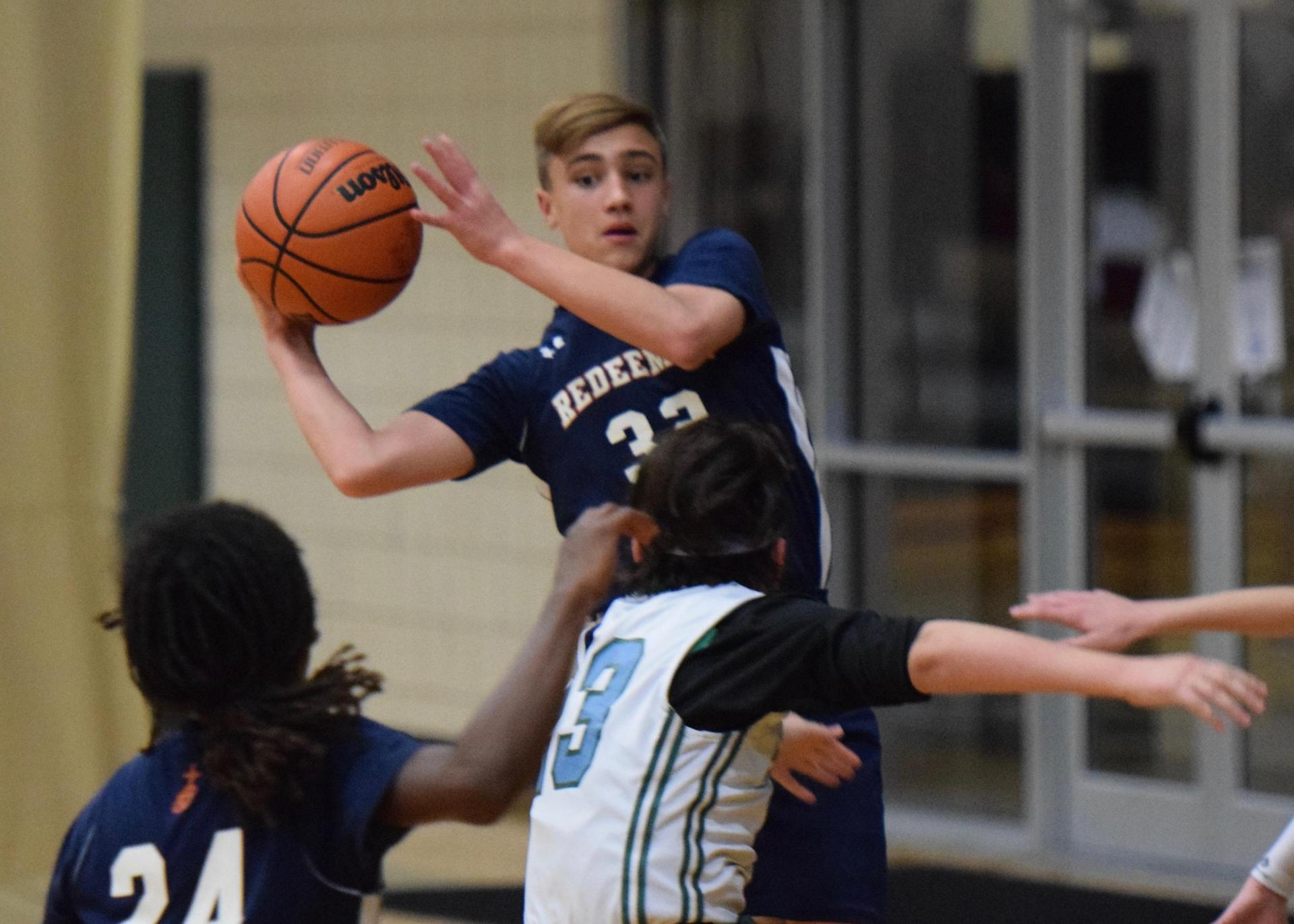Middle school boy playing basketball
