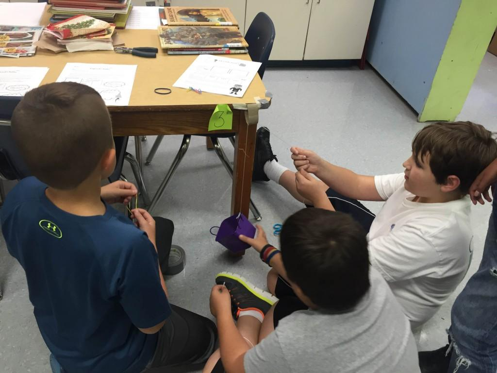 Students building pullys