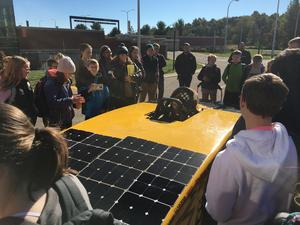 Students check out WMU'S solar car, the Sunseeker, during a field trip.