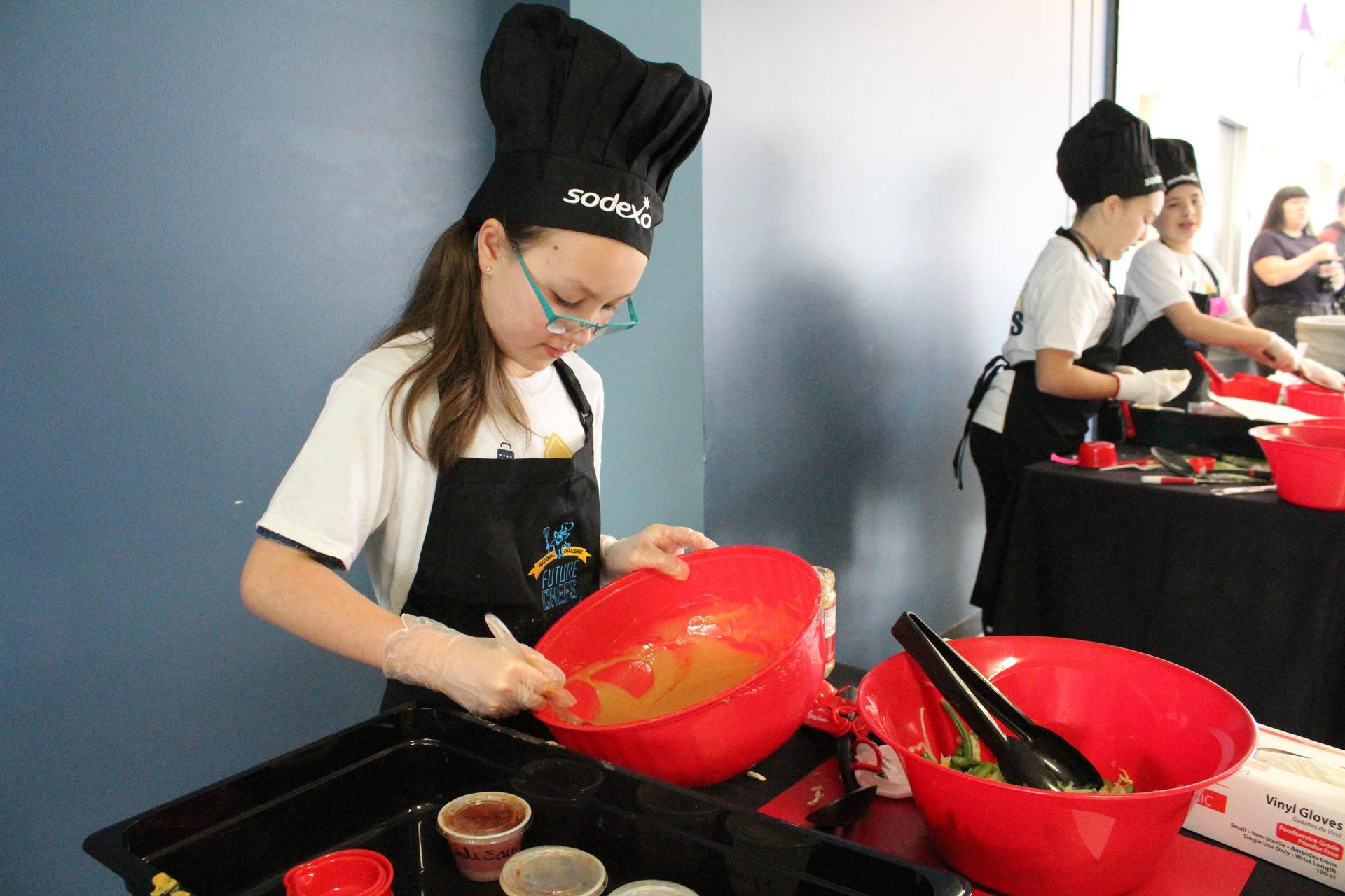 Student cooking in Sodexo 'Top Chef' competition