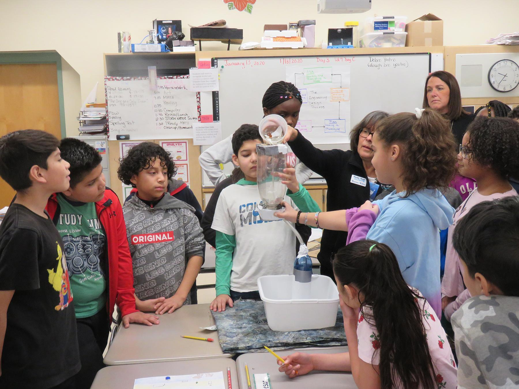 The class experiments with a filtration device