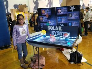 female student with solar system research