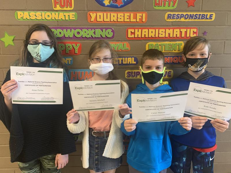 pic of 4 kids with their certificates
