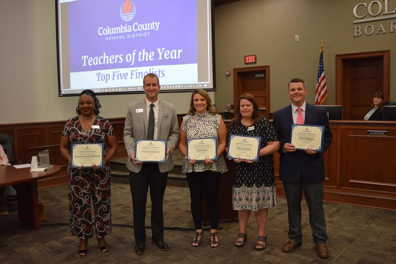 Top 5 Finalists for District Teacher of the Year holding certificates