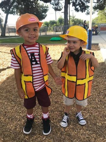 Boys dressing up as construction workers