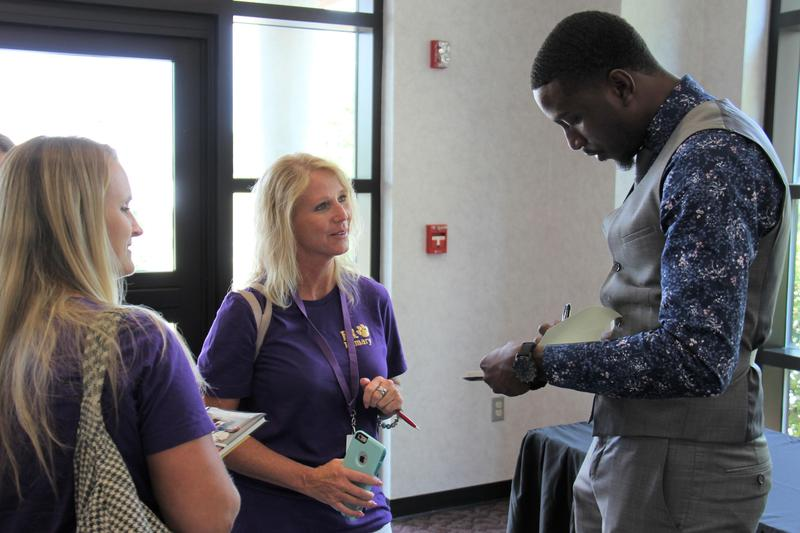 Michael Bonner (right) signs books for B-L Primary School teachers Erika Smith (center) and Kelly Johnson (left).  Mr. Bonner, a nationally-known teacher and visionary leader, served as the keynote speaker for the Back-to-School Convocation for staff in Lexington Three and Saluda County school districts.