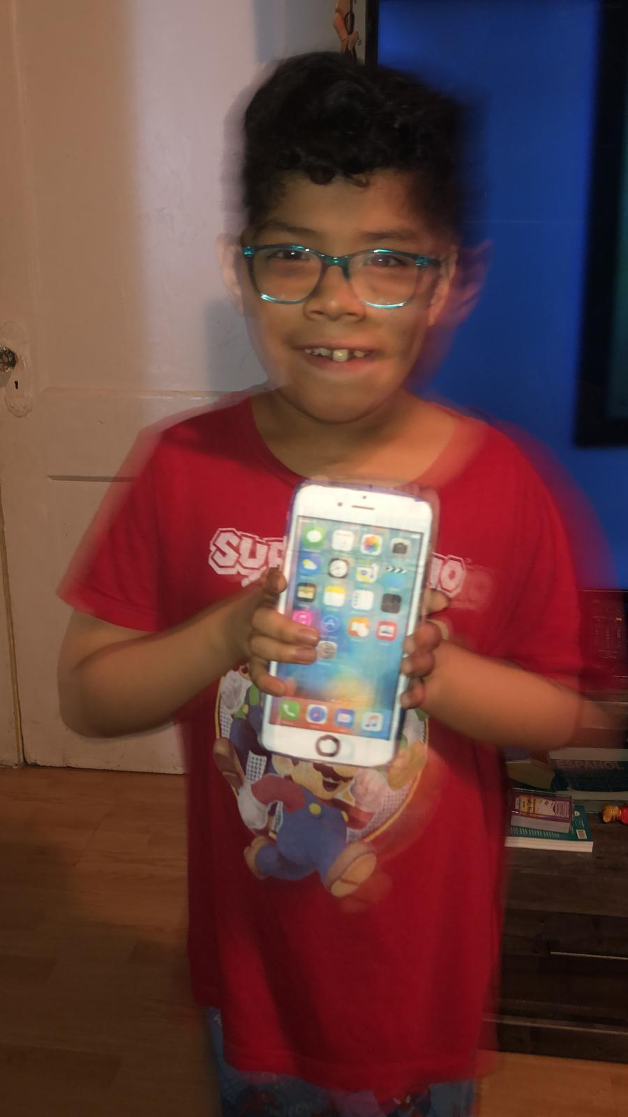 boy holding up iphone