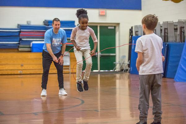 Students in gym jumping rope