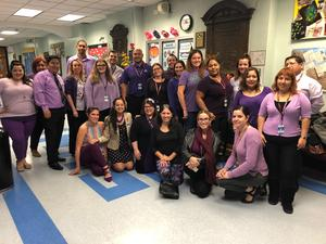 group photo of staff and teachers wearing purple to promote awareness of Domestic Violence