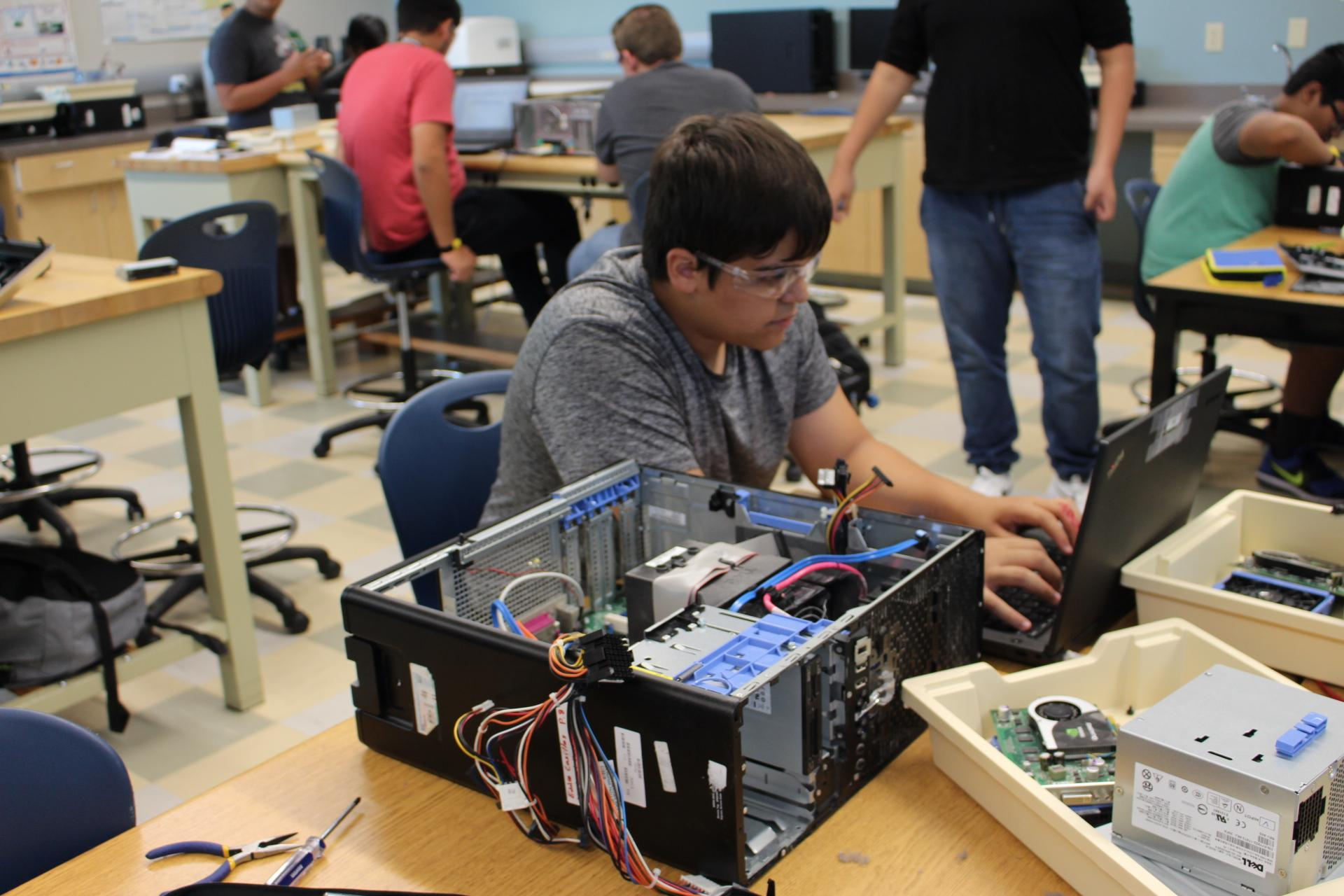 IT students working on a computer