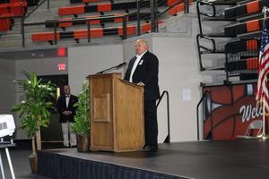 Man at podium speaking to group
