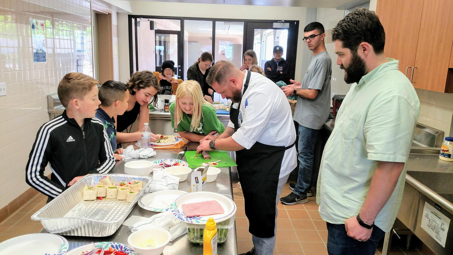 students learning to cook