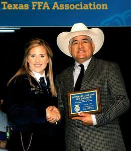 Fernando Perez receiving his award.
