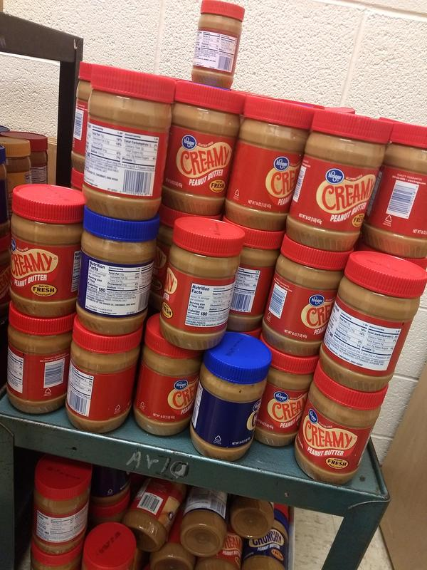 Jars of peanut butter stacked up