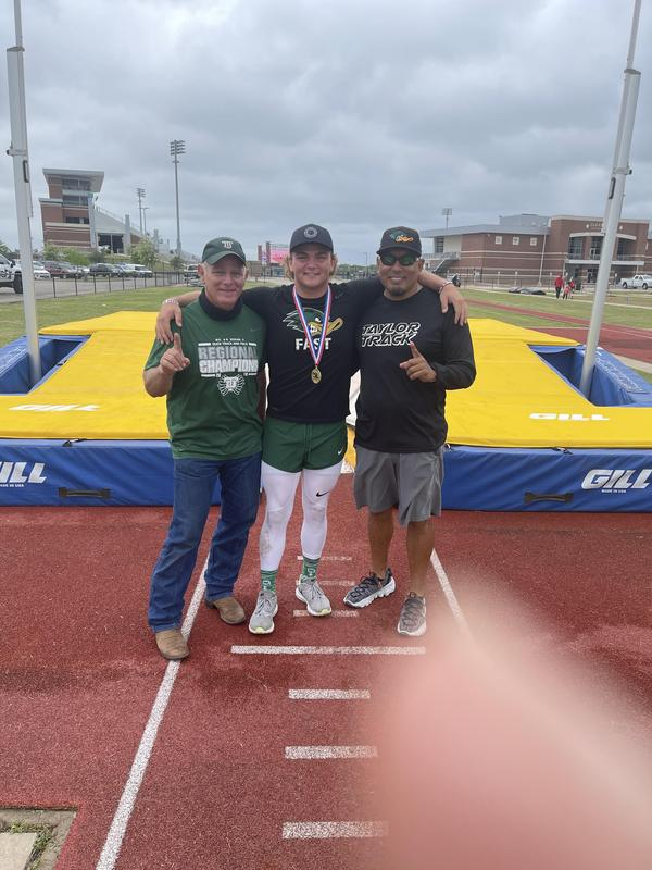 Track champ and coaches.